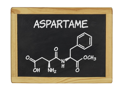 chemical formula of aspartame on a blackboard